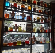 Variety of infused piscos at La Emolienteria