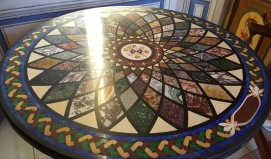 Mosaic table of brilliantly colored marble