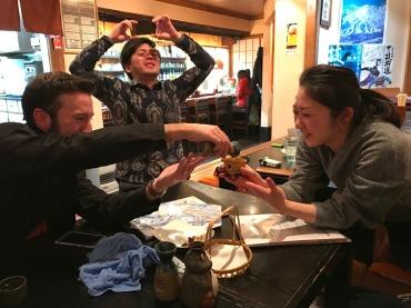 Ryan pouring sake for Kana