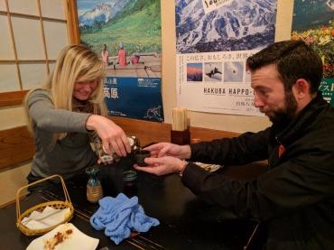 Amanda pouring sake for Ryan