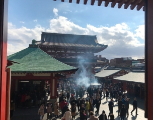 "Smoky center of Sensoji Temple where people seek the ""healing properties"" of the incense"