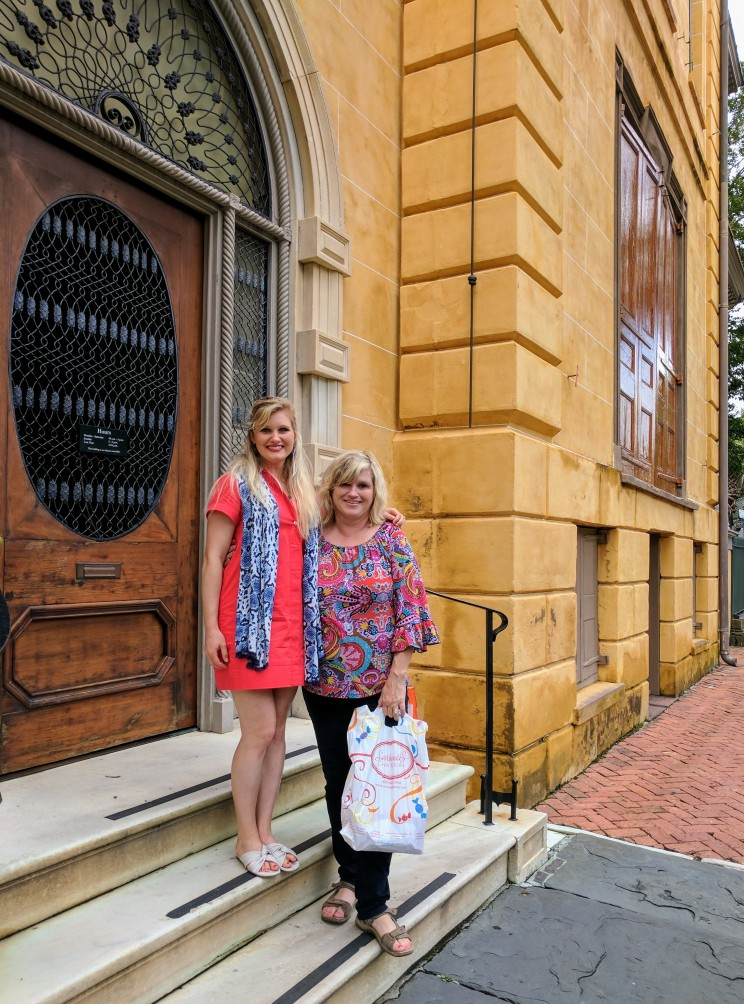 On the steps of the historic Aiken-Rhett House, soggy from the rain