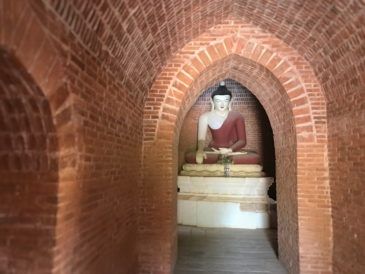 Burmese Budha within a pagoda