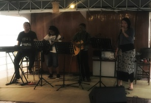 Live band with a girl from our group singing