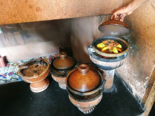 Tajin cooking all day over coals in the High Atlas Mountains outside Marrakech Morocco
