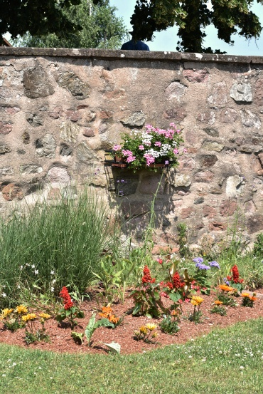 City wall and flowers