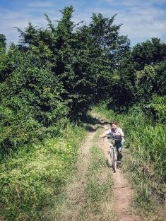 La Coroza boy riding bike with machete